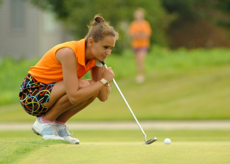 Kristen Watson of Warsaw measures a putt during the home opener at Stonehenge Thursday.