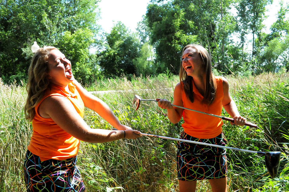 Warsaw girls golfers Nikki LaLonde and Elizabeth Meadows can be all business or all fun. Just give them an option. (Photo by Mike Deak)