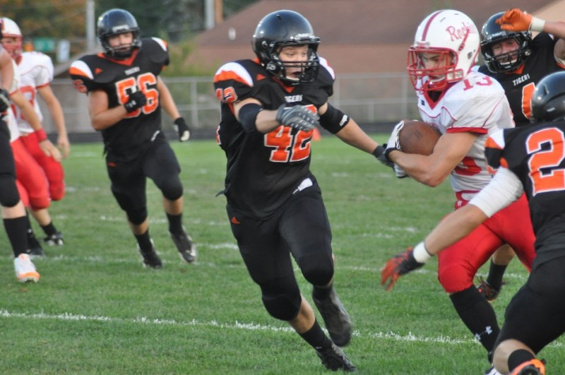 Warsaw linebacker Kyle Heckaman pursues Plymouth's Dakota Brooke Friday night. The Tigers rallied to win 20-19 in their NLC opener (Photo by Amanda Farrell)