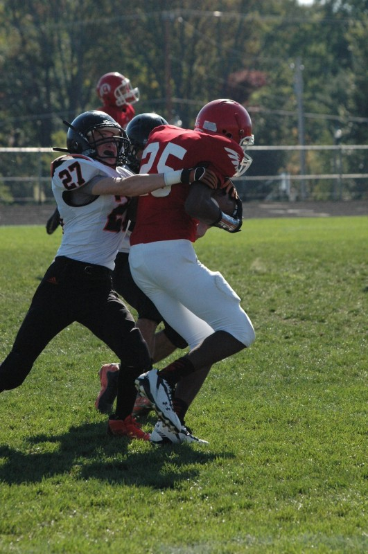 Michael Anderson of Warsaw wraps up a Redskin during JV football action Saturday at WCHS.