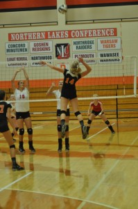 Katie Voelz goes up for a kill attempt for Warsaw Thursday night. The junior had 11 kills as the Tigers beat Goshen 3-0 (Photos by Amanda Farrell)