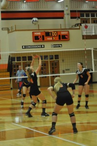 Katie Voelz sets the ball for Warsaw Wednesday. Voelz had 19 kills as the Tigers topped East Noble 3-1 (Photos by Amanda Farrell)
