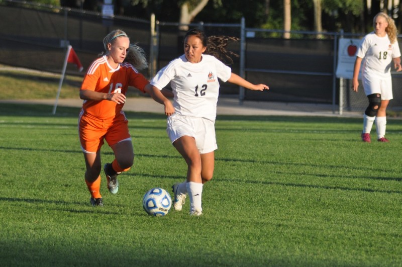 Warsaw senior Zoe Smyth (at right) battles with Northrop's Katie Crisler Monday. The Tigers won 2-0.