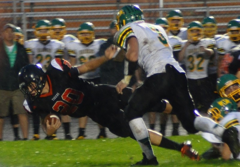 Warsaw's Tristan McClone lunges forward Friday night during a 24-0 home loss to Northridge (Photos by Amanda Farrell)