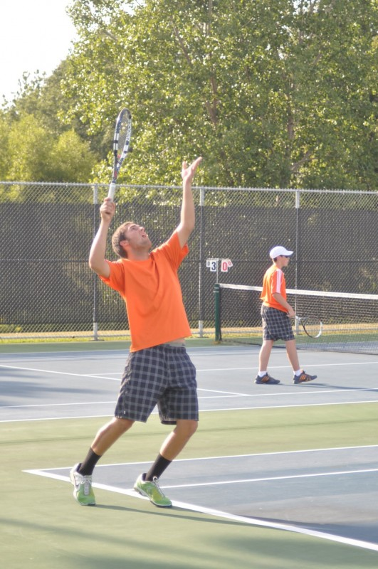 Nikos Schlitt prepares to serve during No. 2 doubles play for Warsaw Wednesday.