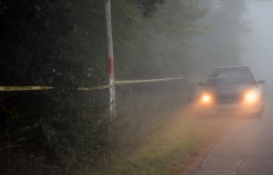 A Kosciusko County Sheriff's Department deputy guarded a wooded area near Suburban Acres Mobile Home Park Sunday evening and all night where it is believed human remains were found. (Photo by Stacey Page)