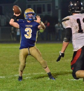 Cole Creighbaum looks to toss a pass over a Falcon defended in the third quarter.