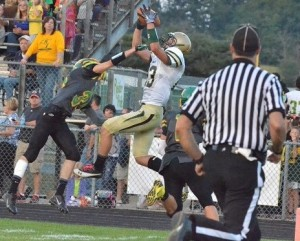 Clayton Cook makes a stellar scoring snag for the Warriors in the second quarter.