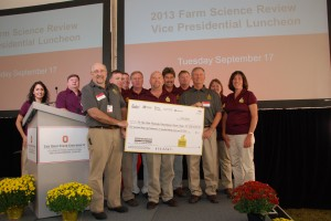 Representatives of Trupointe Cooperative, United Landmark LLC, Heritage Cooperative, Jackson Jennings Co-op and Town & Country Co-op Cooperative present a $138,637.13 check to Drs. Steven Schwartz and Steven Clinton for food-based cancer research at OSU.