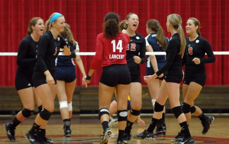 The Grace College volleyball team celebrates during a 3-0 home win over Spring Arbor Friday night (Photo provided by Grace College Sports Information Department)