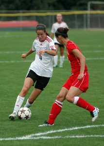 Grace College's Mallory Rondeau works her way through the St. Xavier defense Saturday in a 2-0 win. (Photo provided by Grace College Sports Information)
