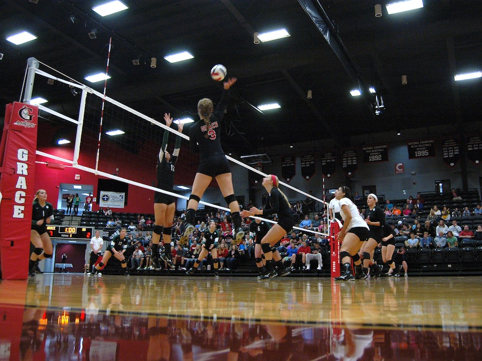Grace College freshman Megan Johnson skies for an attack during a 3-0 conference win over Huntington at home Friday night (Photo provided by Grace College Sports Information Department)