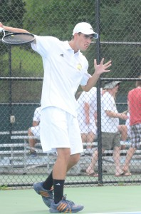 Warsaw senior Kyle Wettschurack  finishes a backhand in a match earlier this season. Wettschurack helped Warsaw beat Northridge 3-2 Tuesday with a win at No. 1 doubles (File photo by Scott Davidson)