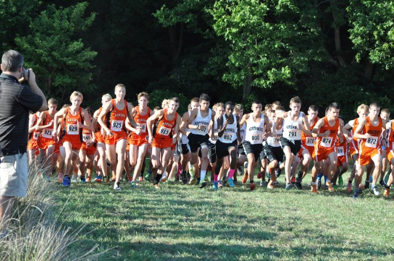 The Warsaw boys' cross country team takes off at the start of the Tiger Classic Tuesday (Photo by Amanda Farrell)