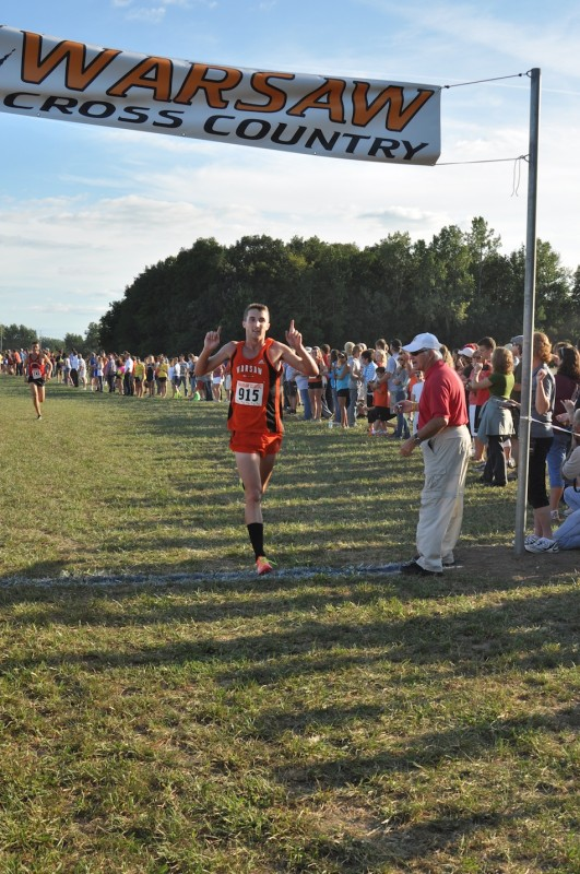 Warsaw standout Ellis Coon crosses the finish line first Tuesday  in the Tiger Classic. Coon led the host Tigers to the team title (Photo by Amanda Farrell)