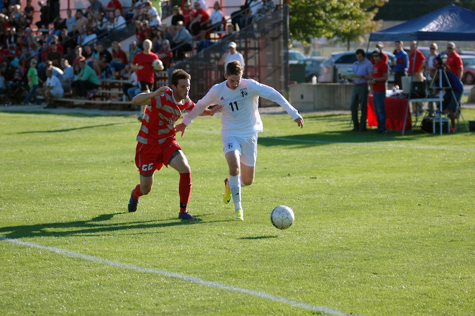 Grace's Steve Fiema controls the ball versus No. 18 Indiana Wesleyan Wednesday. The pair played to a 0-0 draw in a key conference contest in Winona Lake (Photo provided by Grace College Sports Information Department)