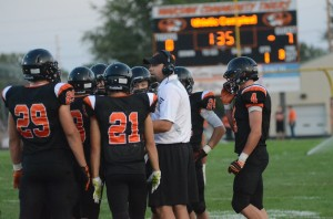 The Warsaw defense listens to coach Kris Hueber Friday night (Photo by Scott Davidson)