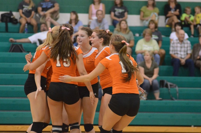 The Warsaw volleyball team  comes together during its match at Northridge Tuesday night.