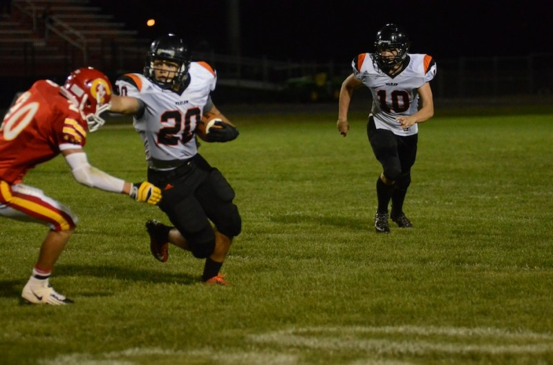 Warsaw's Tristan McClone greets Jared Peen of Elkhart Memorial with a stiff arm Friday night. McClone scored three touchdowns in a 28-0 Tiger win (Photos by Scott Davidson)