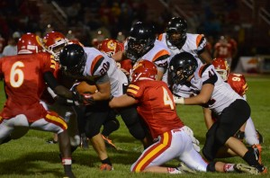 Tristan McClone plows ahead for yardage. The Warsaw star tailback rushed for 146 yards Friday night.