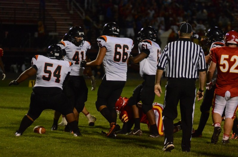 Fullback Jason Taylor (No. 41) is congratulated by his offensive line after a third quarter touchdown for the Tigers Friday night.