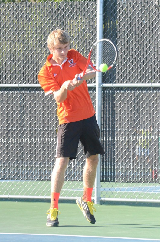Warsaw's Sam Rice makes a backhand return at No. 1 singles Monday versus Penn. The No. 22 Kingsmen topped the host Tigers 4-1 (Photos by Scott Davidson)