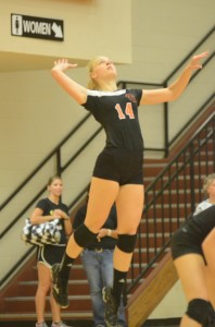 Katie Voelz skies to make a play for Warsaw.The junior middle blocker had a big match in a 3-2 win over Plymouth.