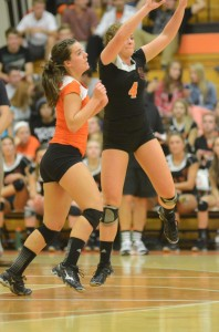 Emily Poe (No. 4) and Marie West almost collide while playing defense for Warsaw Thursday night.