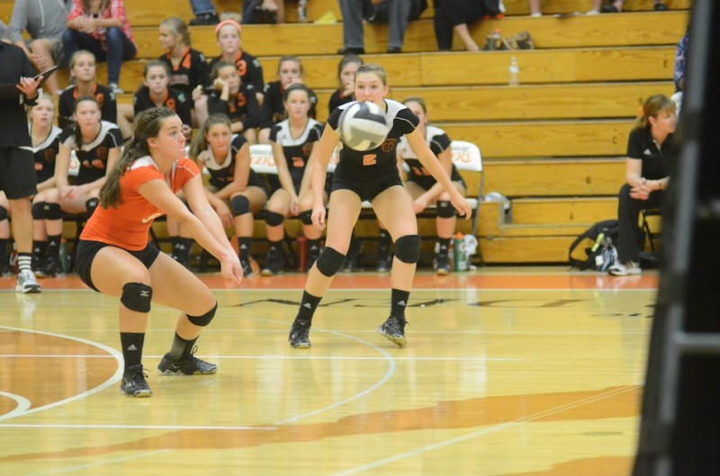 Warsaw senior libero Marie West passes the ball versus Plymouth Thursday night.