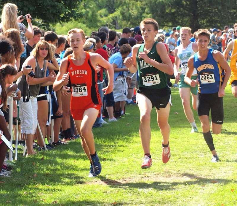 Warsaw's Daniel Messenger leads a trio of runners Saturday.