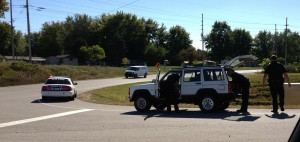 Police search a vehicle along U.S. 30 in Warsaw Thursday after the driver fled officers on foot. (Photo provided)