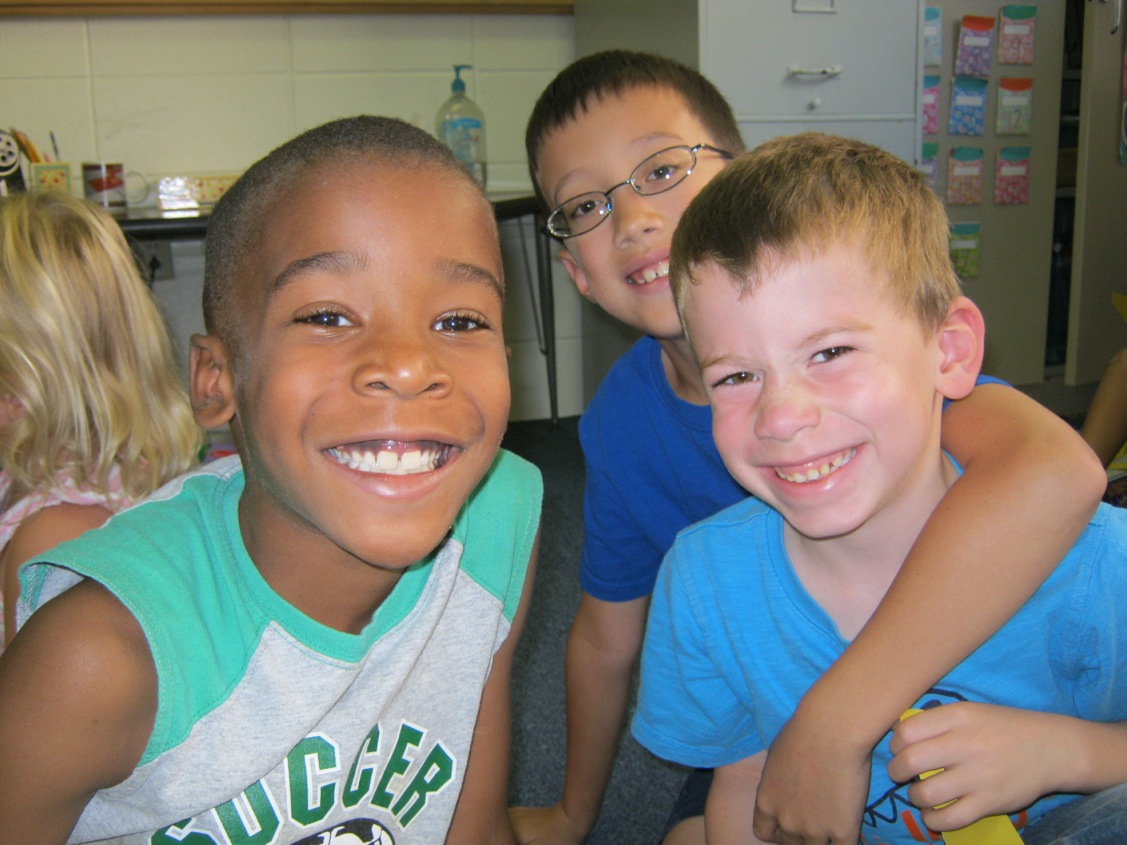Second grader Thomas Alejado (center) spends time with Kindergarteners Issac Meza (left) and Jackson Barros during the time these two classes get together twice a month at Warsaw Christian School.   Kindergarten teacher Mrs. Turner and second grade teacher Mrs. Vida plan special times for the students to meet with a regular buddy or two to read together, do crafts and exercise their creative energies. This peer mentoring program gives both age groups the opportunity to give and receive academic and spiritual encouragement.  (photo provided)
