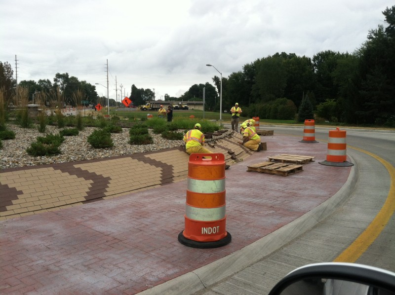 Engineers have begun removing bricks from the Zimmer Road roundabout to determine why the design is failing. (Photo provided by Tim Ellis)