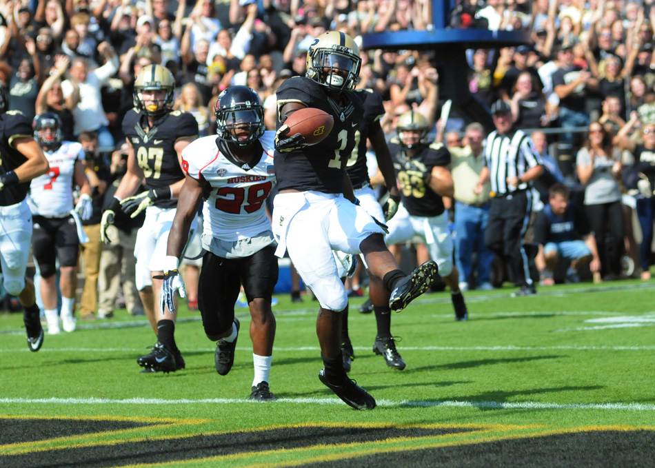 Purdue running back Akeem Hunt crosses the goal line for Purdue's first touchdown of the game.