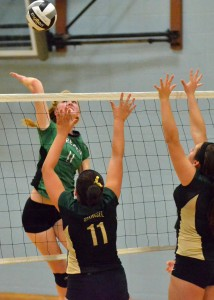 Bremen's Cassie Sears hammers home the game winning kill in the third and final set against Wawasee on Saturday.