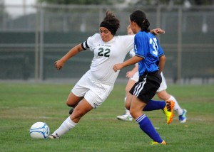 Wawasee midfielder Caitlin Clevenger loads up for a shot attempt while Whitko's Abby Overmyer defends.