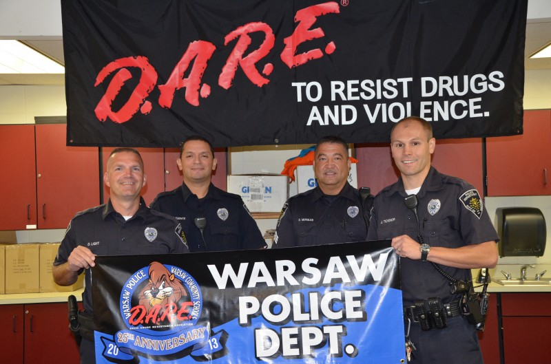 The Warsaw Police Department D.A.R.E. division met today to announce their 25th anniversary teaching students in Warsaw Community Schools.  Photographed (from left) are D.A.R.E. officers Cpl. Doug Light, Cpl. Jaime de la Fuente, Sgt. Dave Morales and Ptl. Jeff Ticknor. (Photo by Alyssa Richardson)