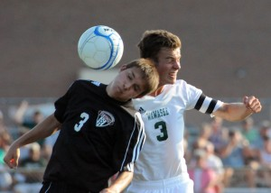 Huntington North's Tyler Henline battles for a header against Wawasee's Jan Jensen.