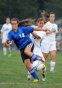 Whitko's Heather Bryan and Wawasee's Natalie Jones tangle up during play.