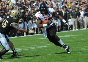 Northern Illinois running back Cameron Stingily finds a hole in the Purdue defense.
