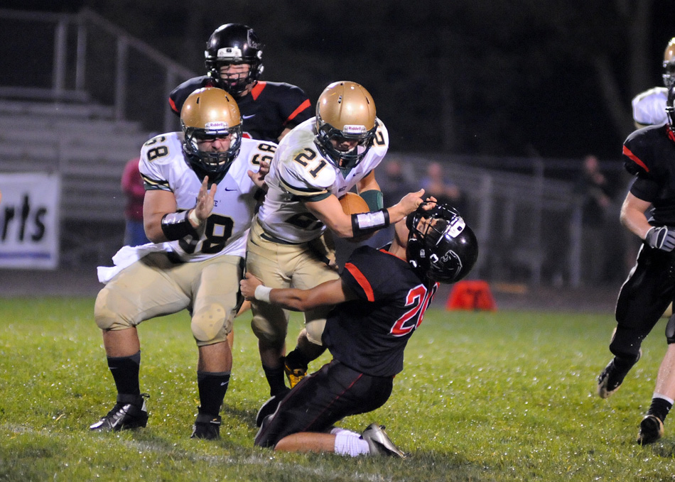 Wawasee running back Brandin McCulloch applies a stiffarm to NorthWood's Trent Sauceda Friday night. McCulloch rushed for 100 yards in Wawasee's 21-16 win at NorthWood. (Photos by Mike Deak)