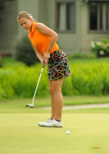 Warsaw senior Elizabeth Meadows putts during a home match earlier in the season. The Tigers will take part in the NLC Tourney Saturday in Goshen (File photos by Mike Deak)