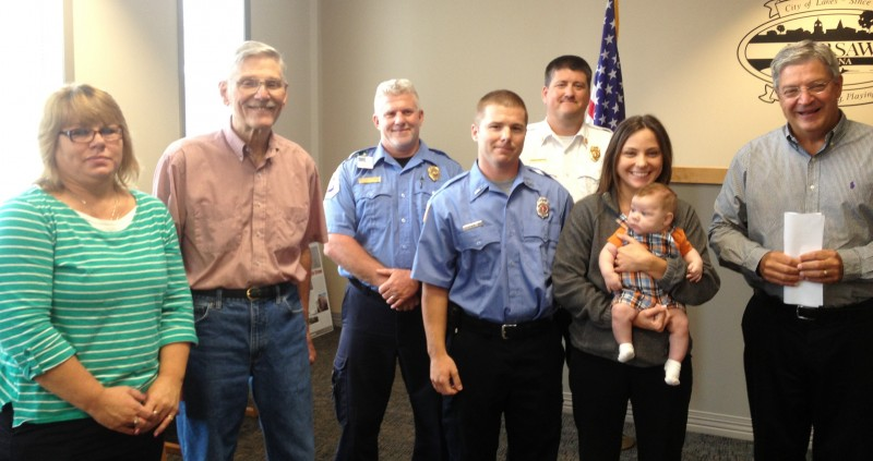 Brandon Allen, center, was sworn in as the newest member of the Warsaw-Wayne Fire Territory.