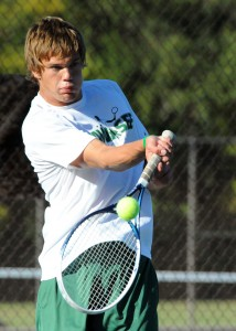 Wawasee's Luke Smith connects during his match with Concord's Jared Searer.