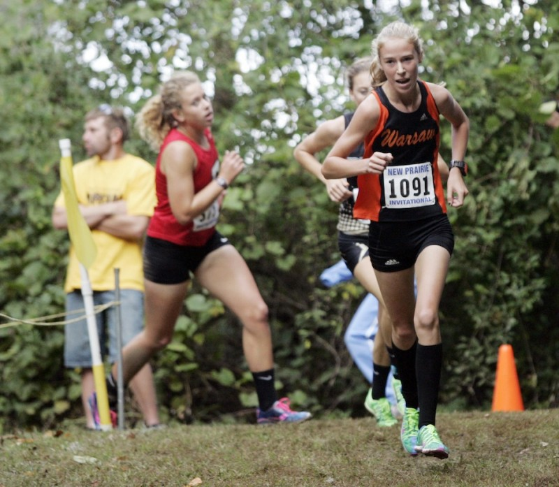 Warsaw freshman Allison Miller turns a corner during action Saturday at the New Prairie Invitational. Miller was 11th overall in the Class AAA race.