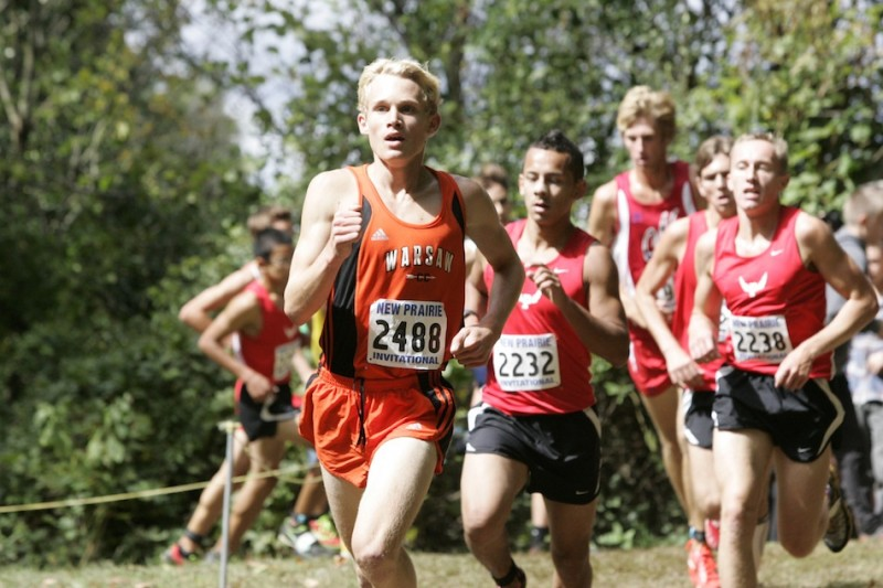 Warsaw sophomore standout Owen Glogovsky leads a pack of runners Saturday at the New Prairie Invitational. Glogovsky was 19th overall to lead the Tigers to a sixth place finish.