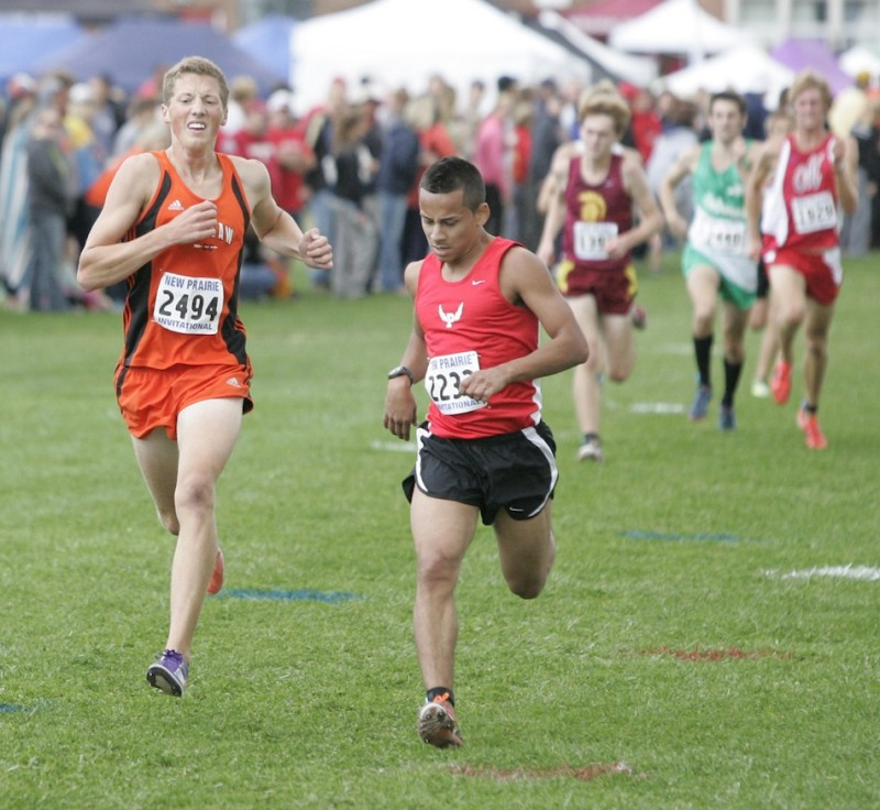 Warsaw's Tyler Houvener (at left) competes Saturday at the New Prairie Invitational.