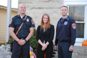 From the left are Chris Francis, fire captain; LeAnne Francis, Mutual Bank; and Jeremy Likens, fire chief. (Photo by Martha Stoelting)