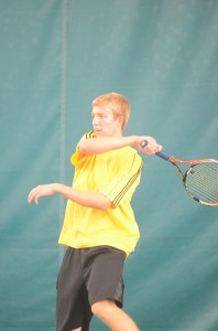 Senior Derrick Cunningham of Tippecanoe Valley finishes a forehand at No. 2 singles Friday.