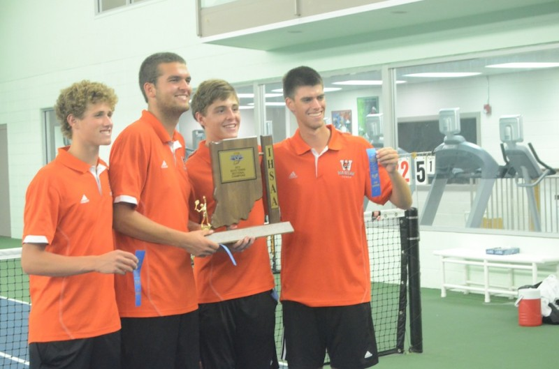 Warsaw seniors Will Petro, Nikos Schlitt, Evan Miller and Kyle Wettschurack display the sectional championship trophy. The quartet leads the Tigers into regional play Tuesday at Culver Academies (Photo by Scott Davidson)